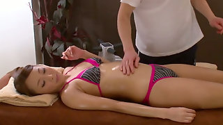 Dark haired female Danni Cole having perfect body oiled during massage  380632